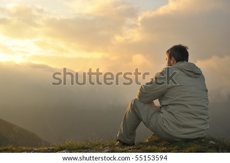 healthy young man practice youga in height mountain at early morning and sunrise