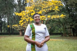 Healthy young woman living with HIV standing in a park in Nairobi, Kenya