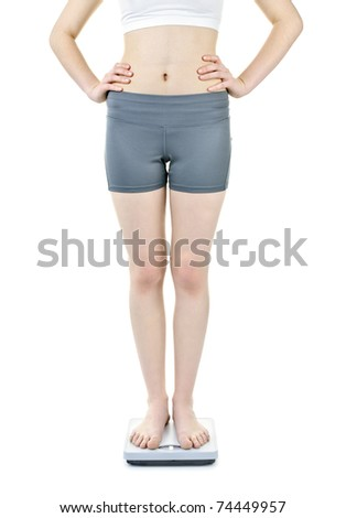 Healthy young woman standing on bathroom scale isolated on white