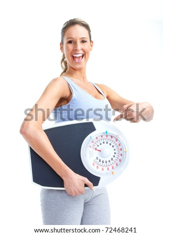 Healthy young woman with a weight scale. Isolated over white background