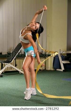 Healthy young woman with dark hair exercising in the gym. health and wellness, as general fitness and dieting