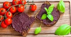 Healty food.  Mini sandwiches from Wholegrain lowcarb  bread with olive pate  and fresh cherry tomatoes