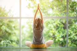 healty women doing yoga in practice at home, time to exercise and relax fitness at home