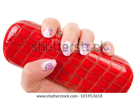 Heand with pink pastel heart manicure with red  glasses holder on the white