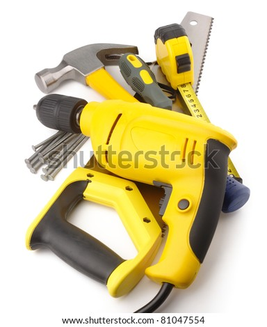 Heap of a few carpenter instruments, isolated over white