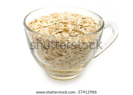 heap of a  flakes from oats in a mug