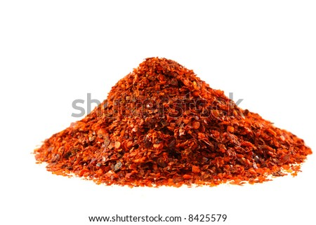 heap of Aleppo Flakes red chilies pepper, soft focus, isolated