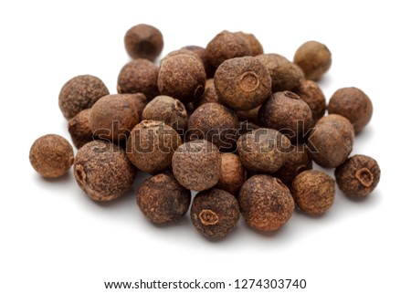 Heap of allspice berries isolated on white background #1274303740