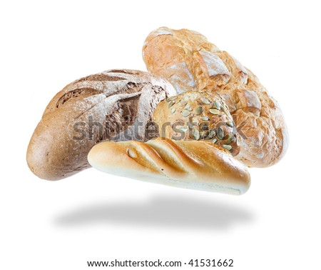 Heap of assortment of bread floating on the air on white background