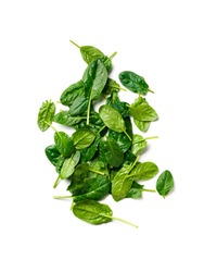 Heap of baby spinach leaves. Fresh green baby spinach isolated on white with clipping path. Top view or flat lay. Vertical.