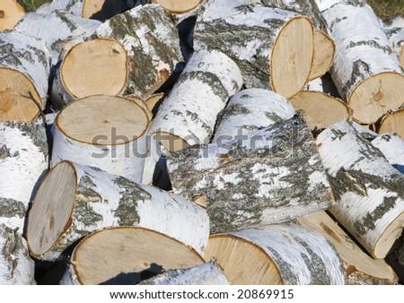 Heap of birch firewood.  Background