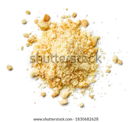 Heap of biscuit crumbs isolated on white background, top view