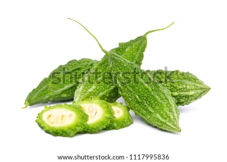 Heap of Bitter melon or Bitter gourd with half sliced isolated on white background (Momordica charantia)