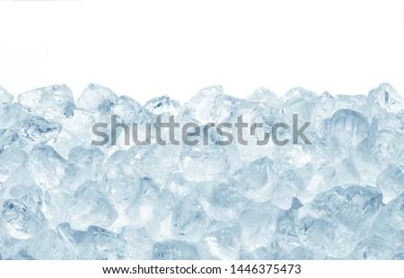 heap of blue crashed ice on white background