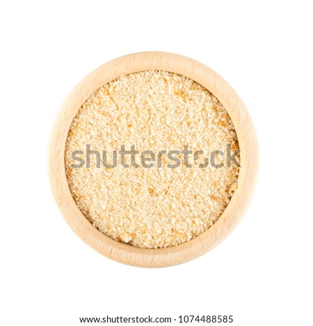 Heap of Bread Crumbs in Wooden Bowl Top View. Crushed Rusk Bread Crumbs or Panko Isolated