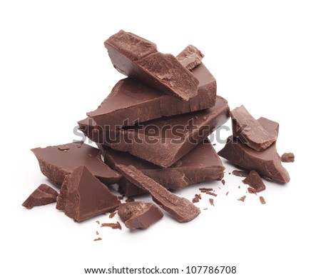 heap of broken pieces of chocolate isolated on white