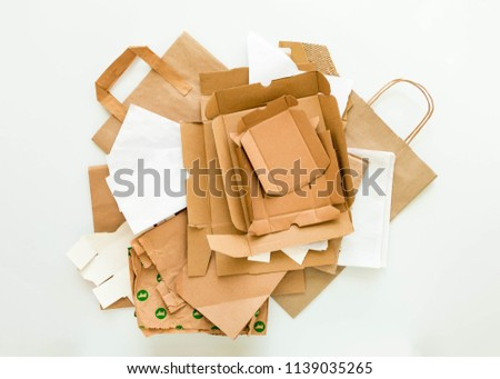 Heap of brown and white eco paper, from used boxes, packages, bags, prepared for recycling. Reduce, Reuse and Recycle concept. Flat lay, view from above