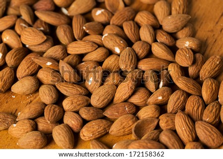 Heap of brown nuts on the table #172158362