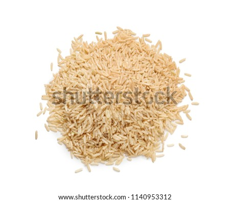 Heap of brown rice on white background
