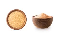 Heap of cane sugar isolated on white background. Heap of brown sugar on white background. Top view. Wooden bowl of dark sugar isolated. Sugar in wooden bowl for cooking, isolated. Selective focus.