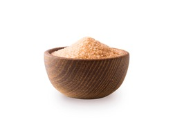 Heap of cane sugar isolated on white background. Heap of brown sugar on white background. Wooden bowl of dark sugar isolated on white background. Sugar in wooden bowl for cooking, isolated.