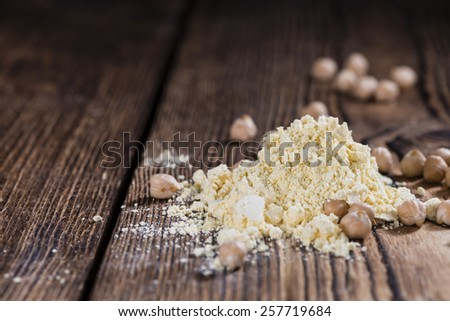 Heap of Chick Pea flour on an old wooden table