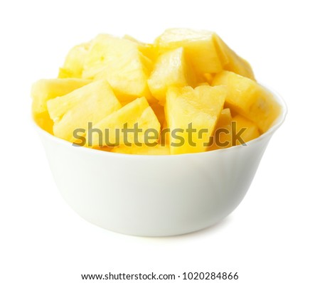 heap of choped cubes of pineapple in bowl isolated on white background