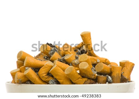 Heap of cigarettes in ashtray over white background