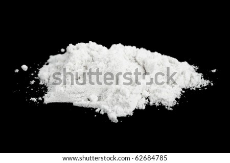 Heap of cocaine isolated on black background