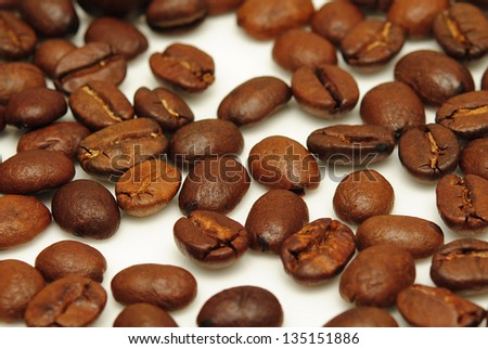 Heap of Coffee Beans isolated on white background on white background