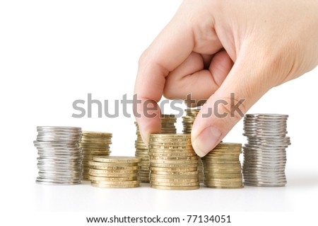 heap of coins and hand isolated on white