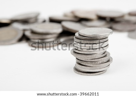 Heap of coins isolated on white