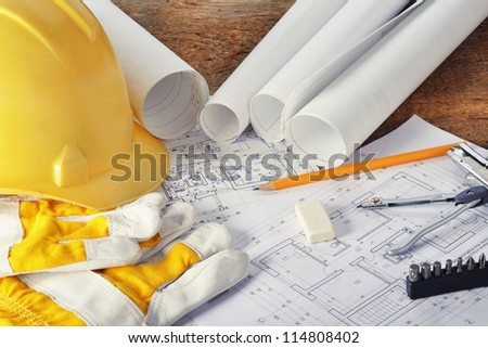 heap of design and project drawings on table background.
