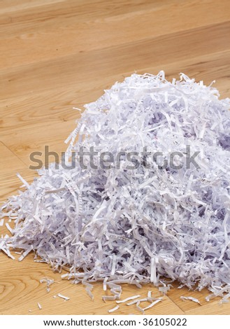 Heap of documents shredded for security purposes on the floor