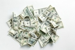 Heap of dollar banknotes on white background