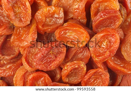 Heap of dried apricots close-up.