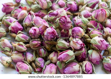 Heap of dried pink rosebuds for tea or aromatherapy. Rosebud textured flower background. #1364897885