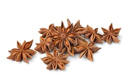 Heap of dried star anise close up isolated on white background