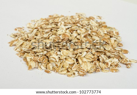 Heap of dry rolled oats isolated on white background #102773774