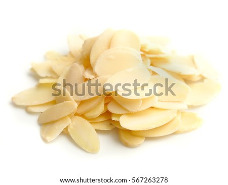 Heap of flaked almonds isolated on white. #567263278