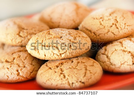 heap of fresh appetizing oatmeal cookies on red plate