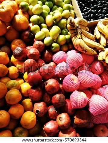 Heap of fresh fruits, India #570893344