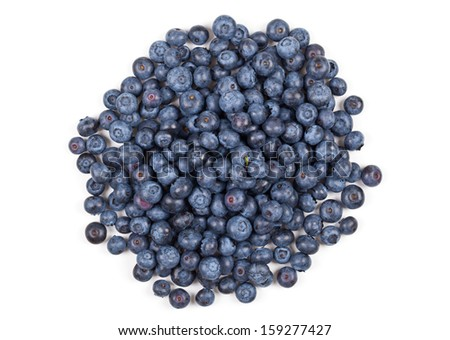 Heap of fresh organic blueberries over white background