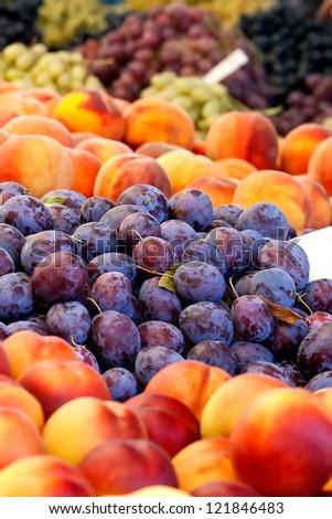 Heap Of Fresh Organic Peaches And Damson Plums At A Turkish Street Market