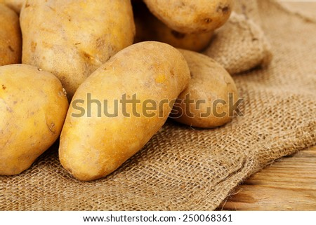 heap of fresh potatoes on burlap sack