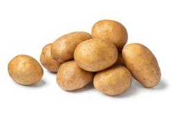 Heap of fresh raw Nicola potatoes isolated on white background