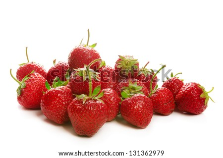 Heap of fresh red ripe strawberries isolated on white