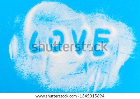 Heap of granulated sugar - text love
