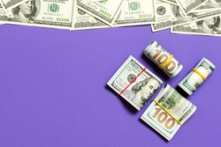 Heap of hundred Dollar Bills on colored background top view, with empty place for your text business money concept.