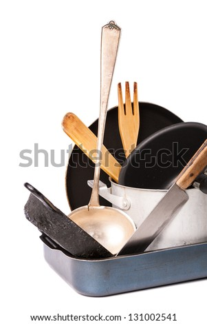 heap of kitchen bakeware with pans and pot - stock photo
